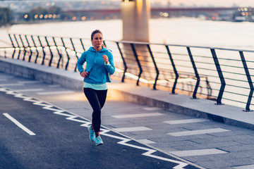 Female jogging on waterfront