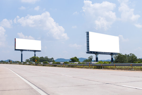 two blank billboard on the highway