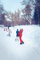 Foto op Plexiglas Wintersporten Happy mother and baby playing outdoors in winter