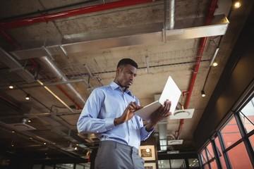 Businessman working over laptop