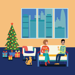 Couple at home sitting on sofa in the christmas room.
