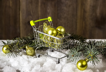 Christmas gifts in a mini shopping cart