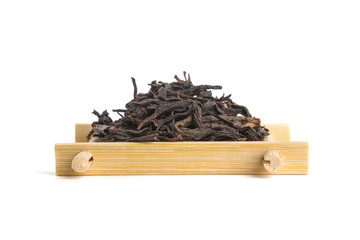Studio shot of Honey Orchid Oolong on bamboo serving tray