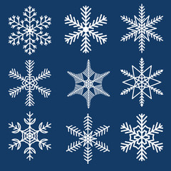 Collection shaped snowflakes on a blue background