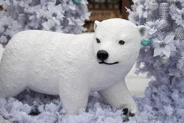 Christmas decoration polar bear, Christmas presents on wooden table.