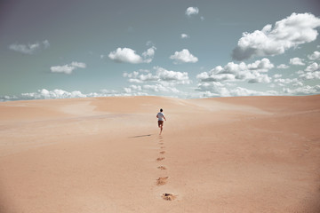 Man running through the desert