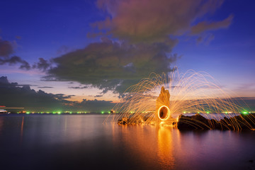 Amazing Fire dancing steel wool  in the twilight.