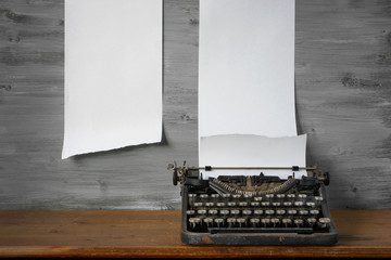 Old typewriter is on the table