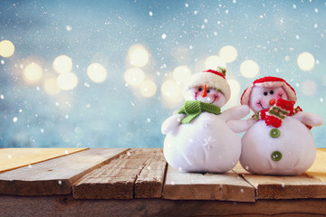 Cute snowman on wooden table