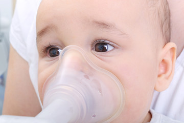 Baby boy gets inhaler treatment for cough