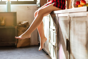 Legs of woman in kitchen