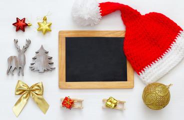 cute knitted santa hat and blackboard