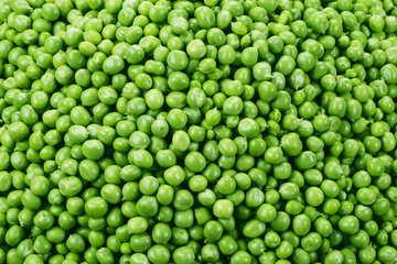 Fresh green peas background. Texture. Top view.