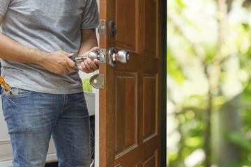 locksmith open the wood door by cylinder tools green bokeh - can use to display or montage on product