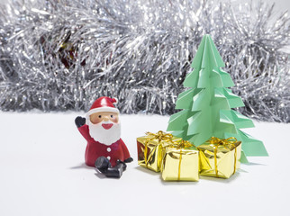 Santa   sitting in front of green Christmas tree waiting for Christmas