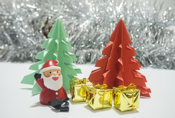 Santa   sitting in front of red and green Christmas tree waiting for Christmas