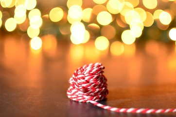 Red and white striped string with bokeh background