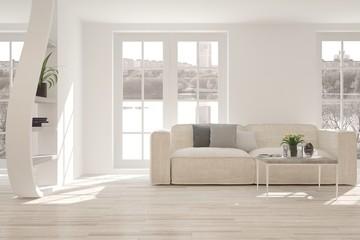 White room with sofa and urban landscape in window. Scandinavian interior design