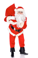 Santa Claus standing with his sack full of presents, isolated on white background. Full length portrait