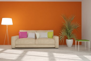 Orange room with sofa. Scandinavian interior design