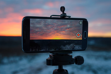beautiful color of sunset on a mobile phone