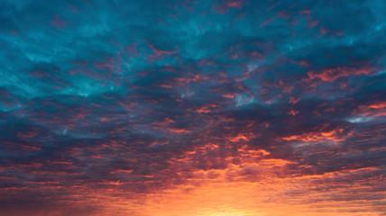 fiery sunset blue sky