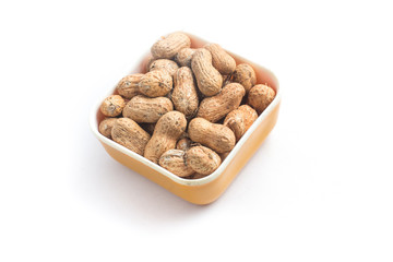 Peanuts pile. Shell Seeds into a bowl