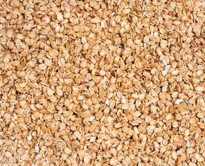 Background of uncooked oatmeal. Close up, top view, high resolution product. Healthy food Concept.