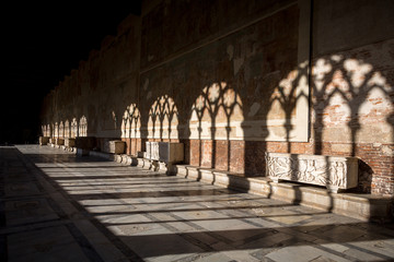 Shadows on the wall. Camposanto building in Pisa, Italy