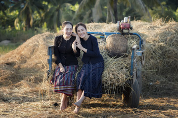 Two young women living in rural agricultural areas.