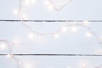 Christmas garland on wooden floor