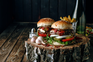 Burgers on rustic background.