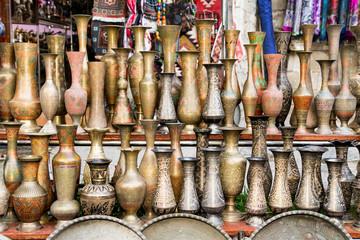 Old oriental antiques barass vases on street market in Baku, Azerbeijan.