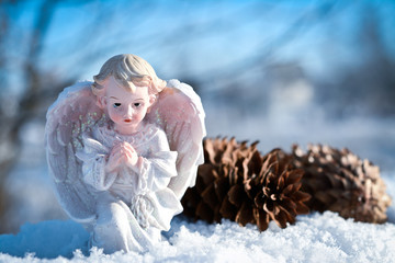 christmas angel in the snow and blue sky
