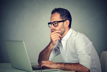 Man working using laptop computer