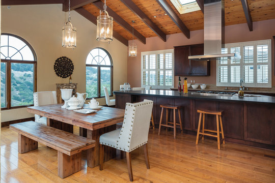 Amazing Wooden Kitchen with dark wood cabinets and island in mediterranean style.