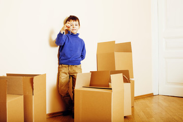 little cute boy in empty room, remoove to new house. home alone, lifestyle people concept