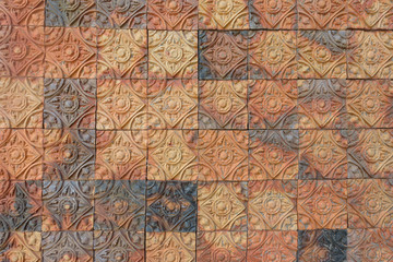 Old vintage earthenware wall tiles patterns handcraft from thail