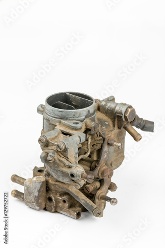 Old dirty used carburetor isolated over white background