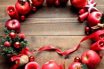 Christmas wreath.Red ribbon Christmas tree and apples