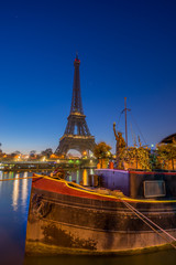 The Eiffel tower at sunrise in Paris France