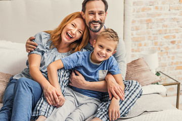 Happy family of three at home