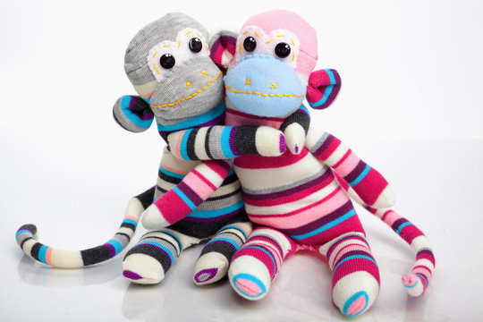 Monkey sock toys isolated on white background. Giving a hug. Ful