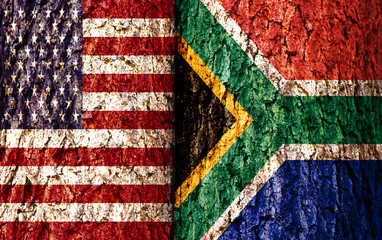 United States Flag and South Africa Flag over crack and grunge wall texture background. Forex USDZAR concept.
