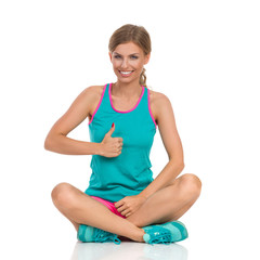 Woman In Vibrant Sports Clothes Gives Like
