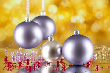 Christmas baubles on abstract bokeh background