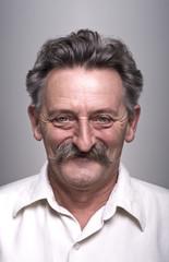 Portrait of proud senior man with mustache.