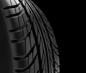 Car tires close-up Winter wheel profile structure on black background - 3d rendering
