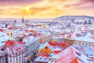 Wall Murals Prague Prague in Christmas time, classical view on snowy roofs in central part of city.