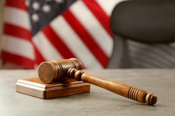 Judge gavel and soundboard on table